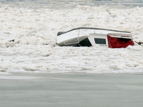 A small boat capsized and trapped in ice. - Zemun, Belgrade